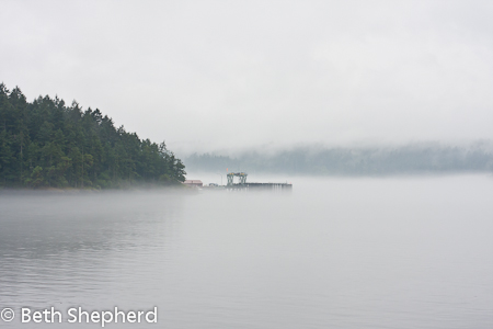 Dock in the mist in Puget Sound