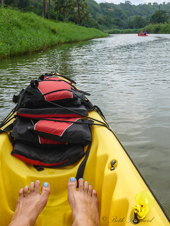 kayak and blue toenails at Hanalei River