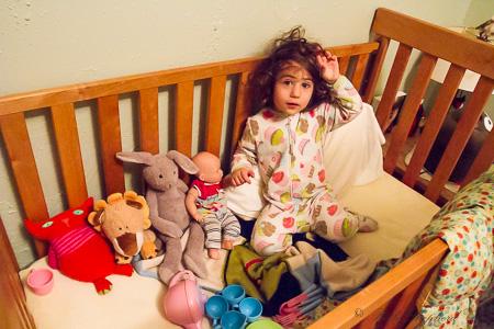 Friends in her crib