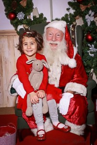 A girl with her bunny and Santa Claus