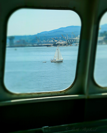 Sailboat through the ferry window