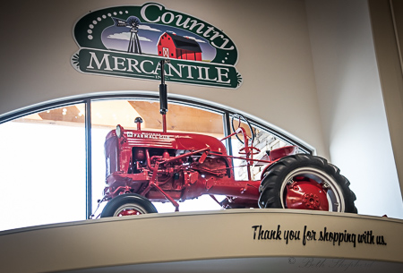 Country Mercantile red tractor in Richland