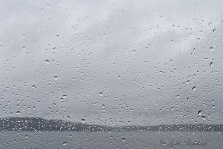 Raindrops on window to Puget Sound