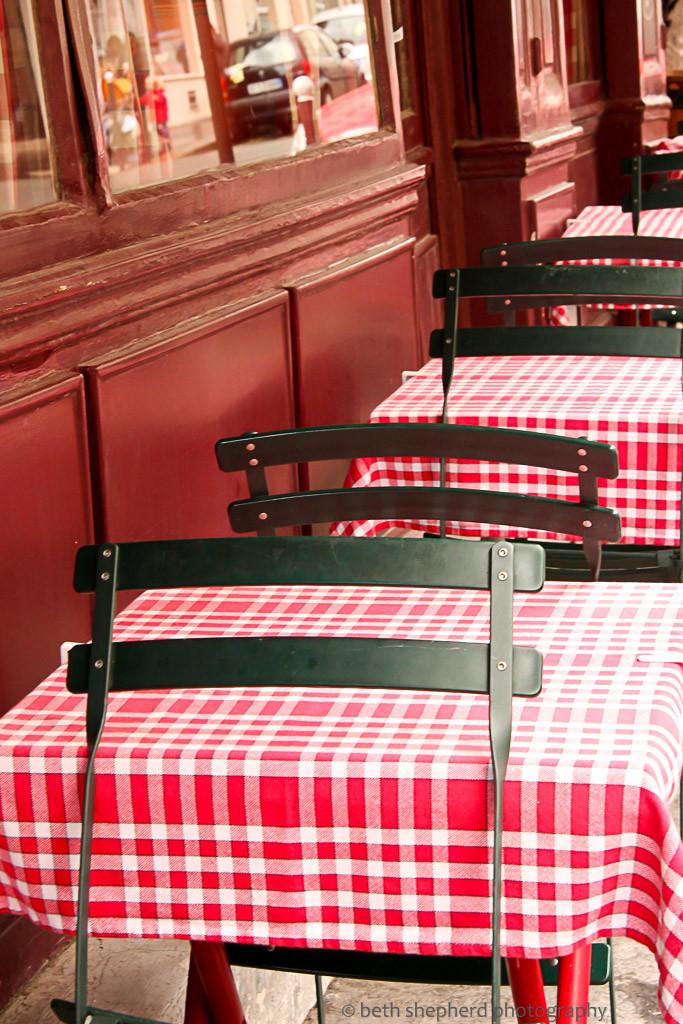 Checkered tablecloths at a Parisian cafe